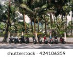 line of scooters parked on a... | Shutterstock . vector #424106359