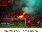 Small photo of July 24, 2015- Shah Alam, Malaysia: Liverpool's fans let off red flares in the spectators gallery after the match between Liverpool FC and Malaysia. Liverpool FC from England is on an Asia tour.