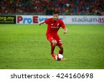 Small photo of July 24, 2015- Shah Alam, Malaysia: Liverpool's Adam Lallana (red) dribbles the ball in a friendly match against the Malaysian Team. Liverpool Football Club from England is on an Asia tour.