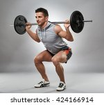 man doing squats with barbell... | Shutterstock . vector #424166914