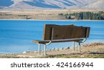 a wooden chair is in front of... | Shutterstock . vector #424166944