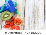 fresh kiwi dumbbell and red... | Shutterstock . vector #424183270