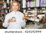 elderly happy woman selling... | Shutterstock . vector #424192999
