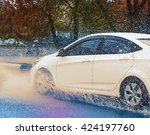 motion car rain big puddle of... | Shutterstock . vector #424197760