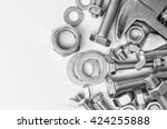 bolts and nuts and a key. | Shutterstock . vector #424255888