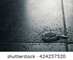 water drips falling on a water... | Shutterstock . vector #424257520