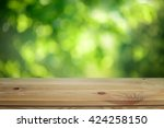 plain wooden table surface on a ... | Shutterstock . vector #424258150