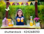 young girl at her lemonade stand | Shutterstock . vector #424268050