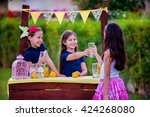 three young girls at their... | Shutterstock . vector #424268080