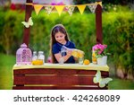 young girl at her lemonade stand | Shutterstock . vector #424268089