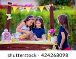 Small photo of Three young girls at their lemonade stand