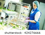 Stock photo buffet female worker servicing food in cafeteria 424276666