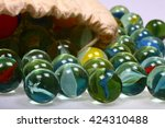 glass marbles spilling out from ... | Shutterstock . vector #424310488