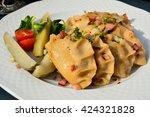 polish pierogi filled with... | Shutterstock . vector #424321828