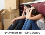 angry evicted couple worried... | Shutterstock . vector #424330099