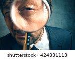 enlarged eye of tax inspector... | Shutterstock . vector #424331113
