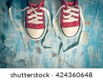 pair of red sneakers from above ... | Shutterstock . vector #424360648