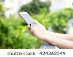 woman texting on mobile phone | Shutterstock . vector #424363549