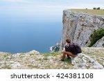 tourist on cliff top | Shutterstock . vector #424381108
