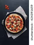 pizza with tomatoes  onion ...   Shutterstock . vector #424391659