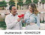 lovely couple drinking apiritif ... | Shutterstock . vector #424405129