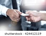 business executive exchanging... | Shutterstock . vector #424412119