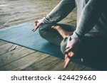 young woman meditates while... | Shutterstock . vector #424429660