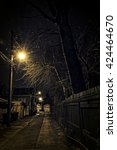 Small photo of Dark Urban Alley at Night