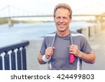 handsome middle aged man in... | Shutterstock . vector #424499803