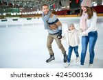 Smiling family at ice skating...