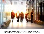 blur of walking people walking... | Shutterstock . vector #424557928