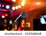 microphone on stage against a... | Shutterstock . vector #424568668