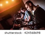 band performs on stage  rock... | Shutterstock . vector #424568698
