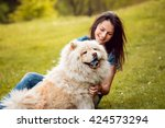 Young Woman With The Dogs In...