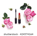 Stock photo decorative flat lay composition with cosmetics and flowers top view on white background 424574164