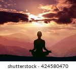 yoga and meditation. silhouette ... | Shutterstock . vector #424580470