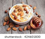 porridge oats with mix nuts and ... | Shutterstock . vector #424601830