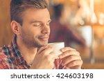 portrait of handsome young man... | Shutterstock . vector #424603198