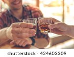 cropped image of two men... | Shutterstock . vector #424603309