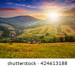 village behind the agricultural ...   Shutterstock . vector #424613188