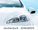 Stock photo auto parts front headlights on a blue sky background 424628203