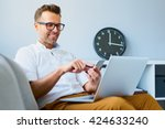 young man using his smartphone... | Shutterstock . vector #424633240