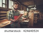 carpenter doing his job in... | Shutterstock . vector #424640524