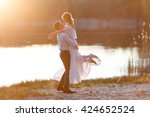 happy couple at sunset. the... | Shutterstock . vector #424652524