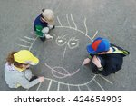 Children Is Drawing Sun On...