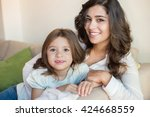 mother and daughter relaxing... | Shutterstock . vector #424668559
