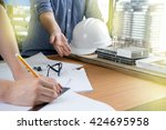 two people engineer work on... | Shutterstock . vector #424695958