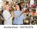 happy women buying dark and... | Shutterstock . vector #424761076
