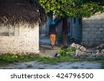 african woman in rural area | Shutterstock . vector #424796500