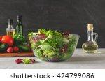 full bowl of fresh green salad... | Shutterstock . vector #424799086